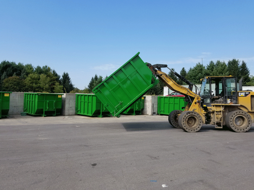 Roll Off Dumpster with Custom Loader Attachment
